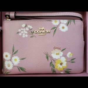 NWT Coach gorgeous floral wristlet with a charm!!